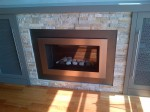 AFTER: Custom hearth and slate ledge stone surrounds new gas fireplace. Residence of Louise and Paul Philp.