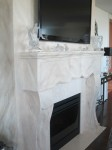 Faux marble fireplace and surround wall. Wuls residence.