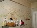 Hand painted swan frieze on plaster. Artist's home.