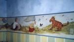 Winnie the Pooh mural. Tan residence.