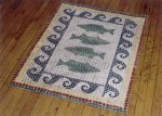 Mosaic tile fish on canvas floor cloth.