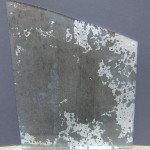 Antiqued glass with silver leaf